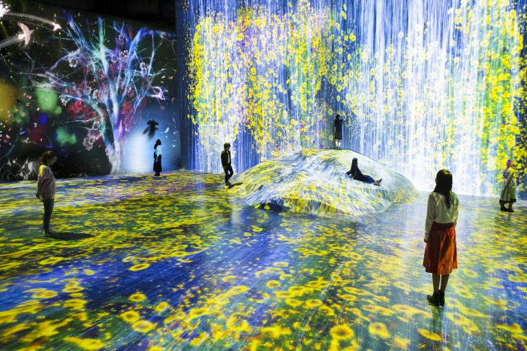 Still from teamLab work called Universe of Water Particles on a Rock Where People Gather