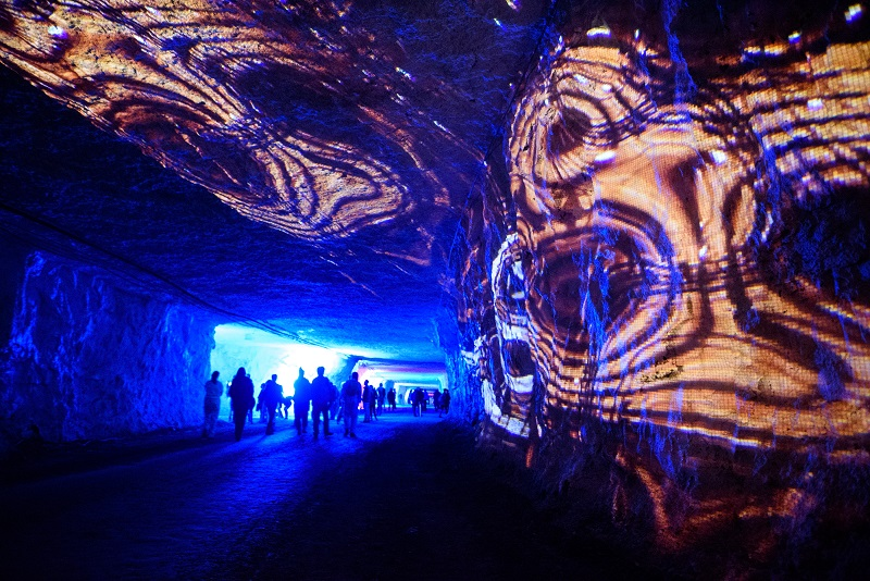 Attendees move through a limestone mine for Carnegie Mellon's SubSurface Event