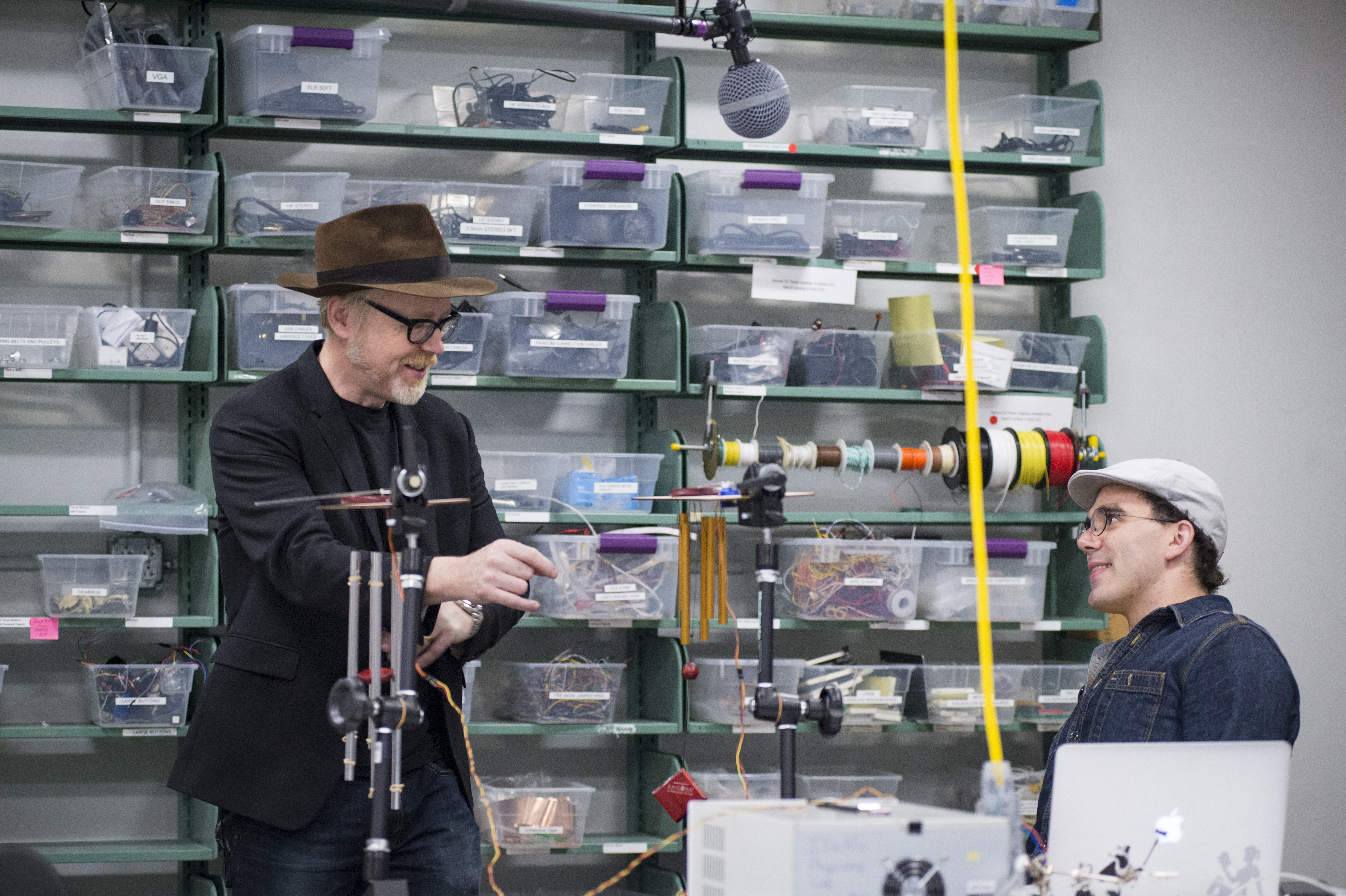 Adam Savage speaks with a student in the IDeATe Physical Computing Lab