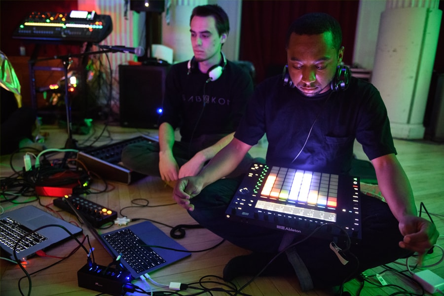 Students perform on electronic music equipment at the Snoozefest event at Carnegie Mellon
