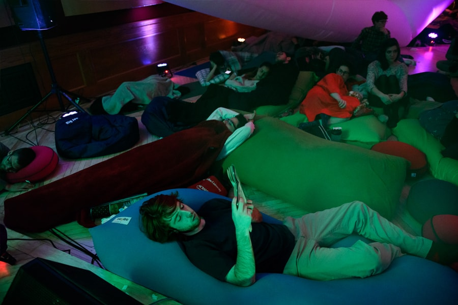 Attendees recline and read books during the Snoozefest overnight concert at Carnegie Mellon